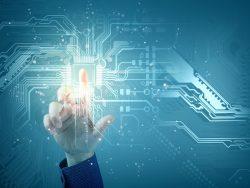 Un doigt touchant un écran interactif faisant apparaître des circuits informatiques.